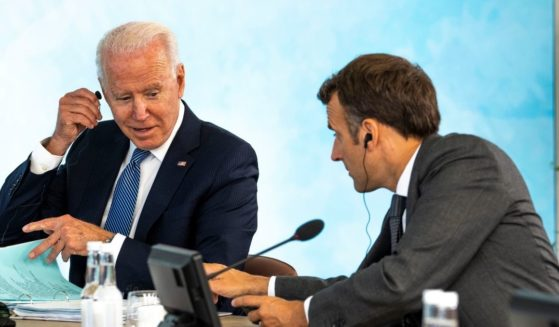 President Joe Biden talks with French President Emmanuel Macron during the final session of the G-7 summit in Cornwall, England, on Sunday.
