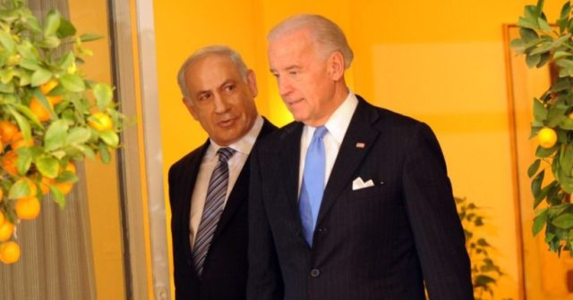 Then-Israeli Prime Minister Benjamin Netanyahu, left, and then-U.S. Vice President Joe Biden walk in the prime minister's residence on March 9, 2010, in Jerusalem, Israel.