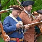Reloading their muskets.