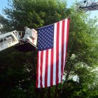 A giant flag was hoisted thanks to fire trucks from Tyngsborough and Westford.