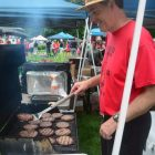 Earle Stokes getting the hamburgers ready.