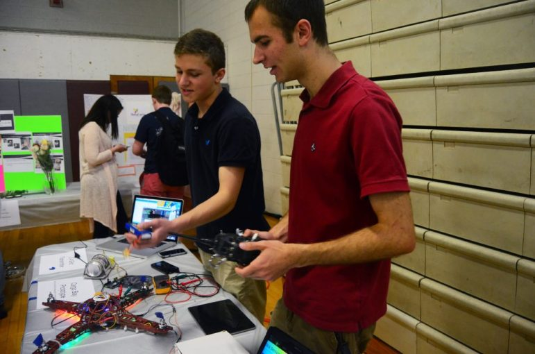 Derek Feehrer (left) and Mike Gillett talk about their quadcopter