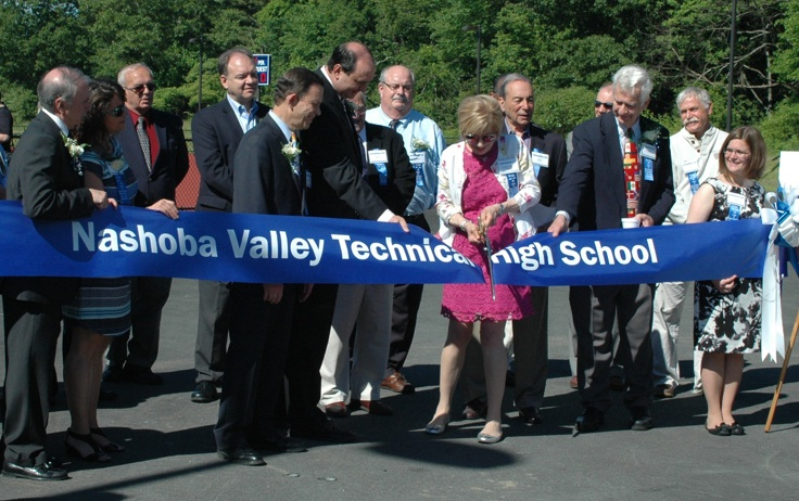 Nashoba Tech Superintendent Dr. Judith L. Klimkiewicz cuts the ribbon to the school's new athletic complex in a ceremony held before the Class of 2014 graduation exercises. Immediately to the left of Klimkiewicz are State Treasurer Steve Grossman and State Sen. James Eldridge. Immediately to the right of Klimkiewicz are former School Committee Chairman Hajo Koester of Westford and Principal Denise Pigeon. (Credit: Derek Rochon)