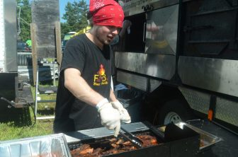 Bobby Cantwell of Firebox prepares food on Sunday.