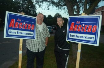 Paul Larkham (left) and Chris Hurst supporting Jim Arciero outside of the Abbot School.