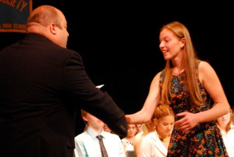 Angela Constantine, a sophomore from Westford, receives her National Honor Society certificate from Assistant Principal Matthew Ricard during Nashoba Tech's recent induction ceremony in the Performing Arts Center. (courtesy - Dan Phelps)