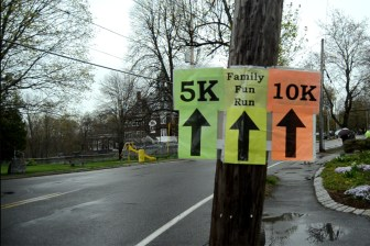 All three parts of the Westford Road Race head down Main Street, then split at the town common.