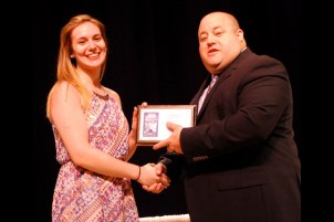 Téa Dellanno of Westford receives an award from Assistant Principal Matthew Ricard during Nashoba Tech's recent Senior Awards Night.