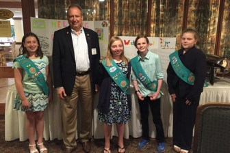 John Flanagan with members of Girl Scout Troop 85009 at a Westford Rotary meeting (courtesy photo)