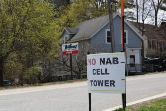 A lawn sign signals the sentiment along Brookside Road where a proposed cellular facility could be built behind the Willow's Pizza restaurant. PHOTO BY JOYCE PELLINO CRANE