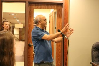 Ram Bhatt of Unicorn Drive voices his concerns about the proposed dog park on Farmer Way which would abut his property. PHOTO BY JOYCE PELLINO CRANE
