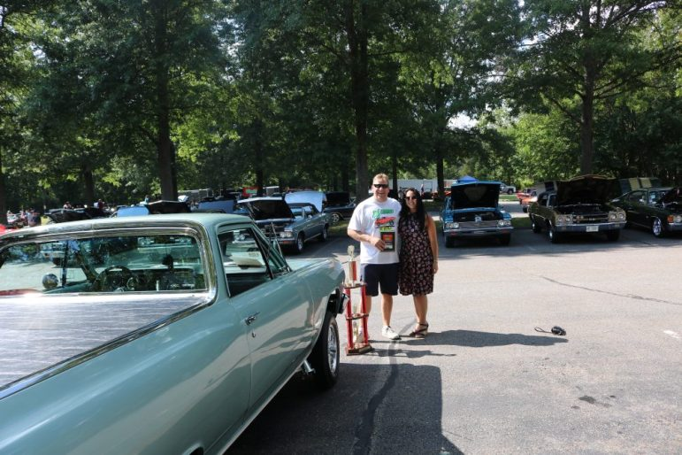 Peter Dayotas' (left) 1965 El Camino 427 five-speed gaser won first prize. Also ipictured is Andrea Tirocchi of Warwick, Rhode Island. PHOTO BY JOYCE PELLINO CRANE