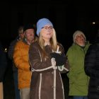Westford resident Sunny Killoran listens, Dec. 6 in the town Common, as speakers seek to raise awareness of the lives touched by gun violence in the U.S. PHOTO BY JOYCE PELLINO CRANE