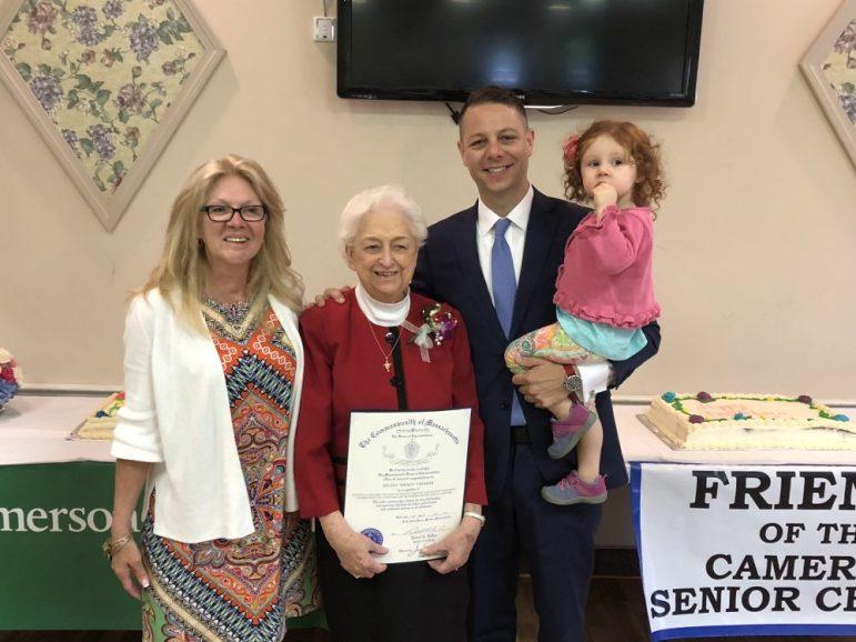 "Resident Nancy Cook congratulates Helena ""Mickey"" Crocker on her upcoming milestone birthday as State Rep. JamesArcieroand his daughter, AngelinaArciero present Crocker with a citation. COURTESY PHOTO"