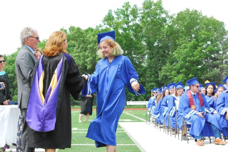 Hannah Schmider of Westford receives her diploma from Lt. Gov. Karyn Polito during Nashoba Tech's graduation ceremony. COURTESY PHOTO