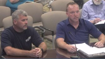 National Grid United Steelworker Jim Pittman (right) accompanied by an unidentified union member, addresses selectmen on Aug. 14. WESTFORDCAT PHOTO