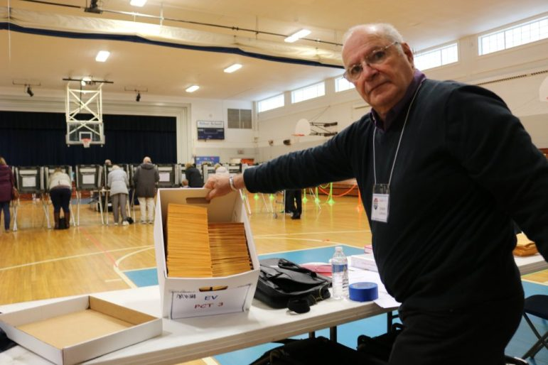 Joseph Lapiana displays a box containing 508 ballots cast by early voters for the Nov. 6, 2018 election. PHOTO BY JOYCE PELLINO CRANE