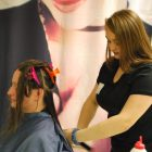 Taylor Short of Westford, a junior in the Cosmetology program at Nashoba Tech, shows off her skills during Open House, styling the hair of her mother, Angela Hillman. COURTESY PHOTO
