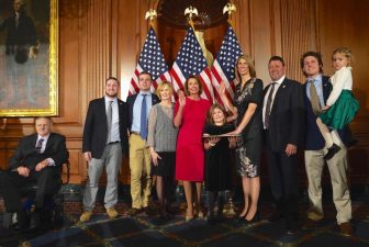 Surrounded by her family, U.S. Rep. Lori Trahan is sworn into office by House Speaker Nancy Pelosi. COURTESY PHOTO
