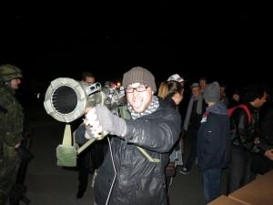 Westin holds a rocket launcher.