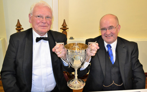 'Good health'. Gordon Brown (left) and Alan Long raise the 'Loving Cup'.