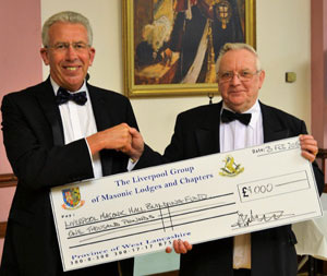 Mark Matthews (left) presenting a cheque to David Sayce.