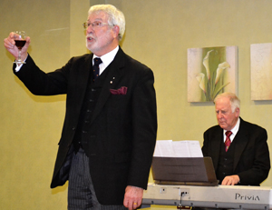 John Chesters (left) performing the 'principals song' with Malcolm Worsley on the keyboard.