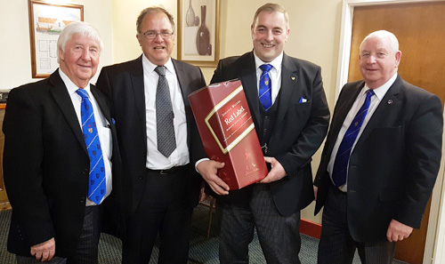 Pictured from left to right at the presentation of the group whisky draw prize, are: Jim Wilson, Andrew Keith, Scott Devine and Harry Cox.