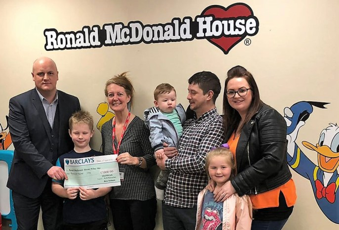 Pictured are Lee Taylor-Craddock (left) presenting the cheque to Lynne Wright, representing Ronald McDonald House and surrounded by the Barton family.