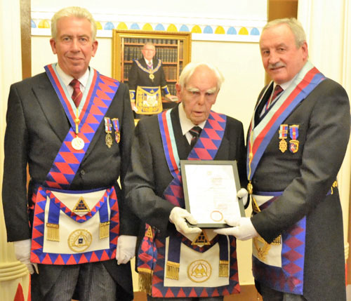Pictured from left to right, are: Mark Matthews, with Les Cairns receiving his 50-year certificate from Sam Robinson.