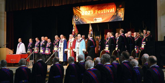 The Grand Superintendent and his officers assemble on the stage area.