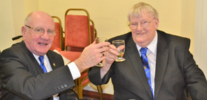 A toast to the celebrant: David Grainger (left) with Colin Martin.