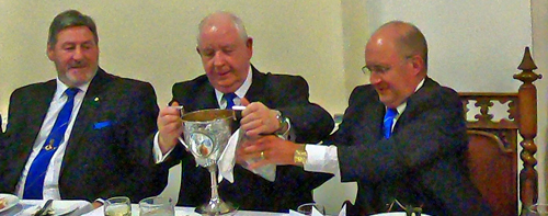 Harry Cox with the 'Loving Cup', together with Neil McGill (left) and Alan Long