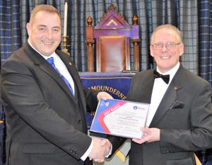 Scott Devine (left), presenting the Patron's certificate to Ian Cuerden.