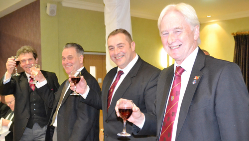A toast to the principals. Pictured from left to right, are: Michael Threlfall, Neil Hartley, Scott Devine and Brian Stoddart.