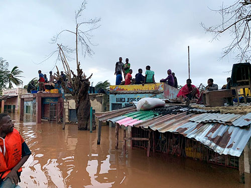 People sheltering on rooves of buildings in Buzi district, Mozambique.