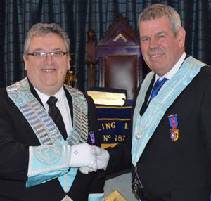 Installing Master John Eccles (right) congratulates his successor Andrew Jones on again becoming Master of Pilling Lodge.