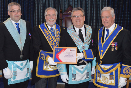 Pictured at the presentation of the MCF 2021 Festival Patron certificate are, from left to right, lodge charity steward Alun Jones, Philip Gardner, Andrew Jones and Simon Hanson.