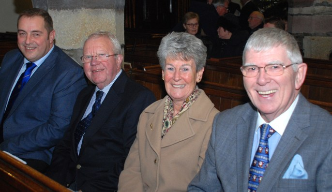 Enjoying the Christmas carols, from left to right, are: Scott Devine, Keith Kemp and Maureen and Tony Harrison.