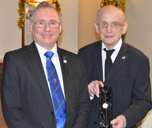 Geoff Morrow (right) receiving his wrist watch from his son in law Paul Taylor, on behalf of Vale Lodge.