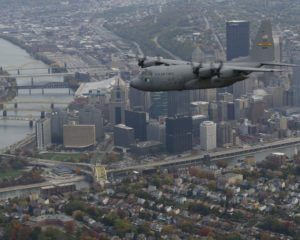 U.S. Air Force C-130 Hercules from the 911th Airlift Wing flies over Pittsburgh during a formation flight training exercise in which aircrew members trained on two-ship formations, run-ins, and low-level routes, October 18, 2012. The mission of the 911th is to organize, recruit and train Air Force Reserve personnel and to provide airlift of airborne forces, their equipment and supplies and delivery of these forces and materials by airdrop or airland operations. (U.S. Air Force photo by Tech. Sgt. Christine Jones/ Released)