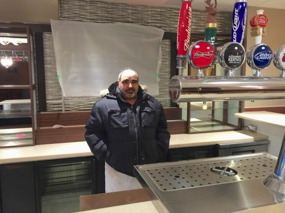 Frank stands behind the new bar.