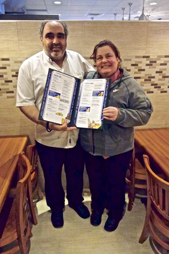 Frank and Niki proudly hold the new menu.