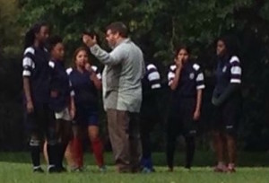 Coach Bould with the junior girls rugby team.