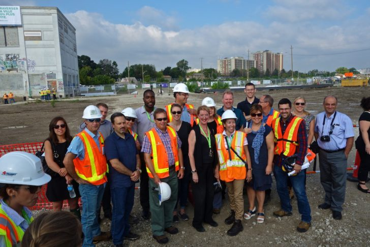 Metrolinx workers pose to mark the occasion.