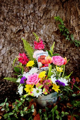 Bright, colorful mix of seasonal flowers in a rustic, tin pail. $50.00