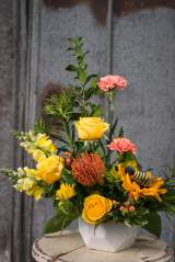 $50. Yellow roses with coral accents, bee adornment