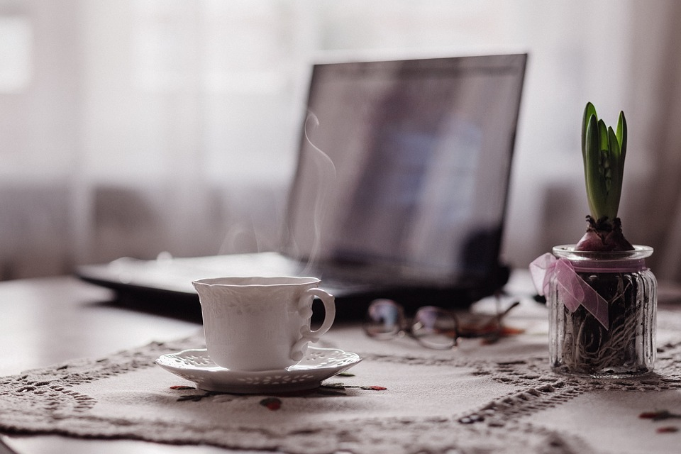 stock image of tea cup near laptop