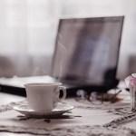 stock image of tea cup near laptop