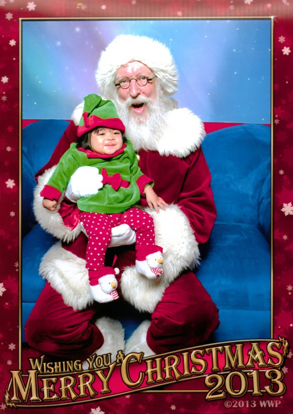 Aria Hope visits Santa for the first time at Westside Pavilion Mall.  Photo by Worldwide Photography